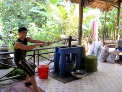 G working out at Mekong coconut factory